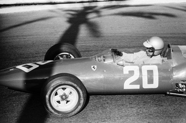 Lorenzo Bandini, Ferrari 156 Aero, passes through the shadow of a palm tree at Station Hairpin.