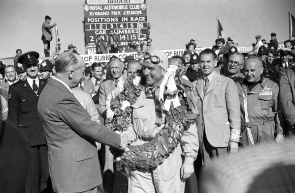 Giuseppe Farina is congratulated on his victory.