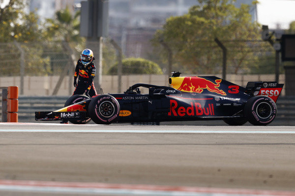 Daniel Ricciardo, Red Bull Racing RB14, climbs from his car after stopping on track