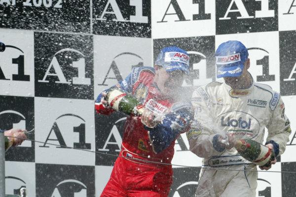 2002 F3000 ChampionshipA1-Ring, Austria. 11th May 2002.Enge, Wirdheim and Haberfeld celebrate on the podium.World Copyright: LAT Photographicref: Digital Image Only