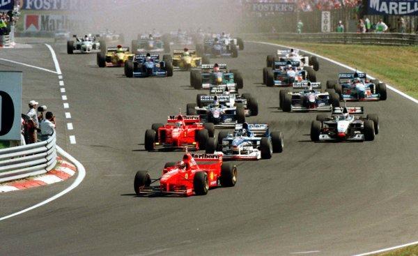 1997 Hungarian Grand Prix.Hungaroring, Budapest, Hungary.8-10 August 1997.Michael Schumacher (Ferrari F310B) leads Damon Hill (Arrows A18 Yamaha) at the start of the race.World Copyright - LAT Photographic