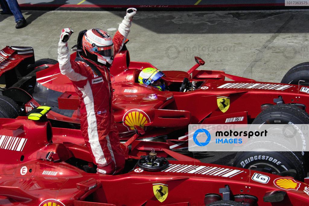 Winner Kimi Raikkonen celebrates victory in parc fermé with teammate and 2nd placed Felipe Massa alongside him.