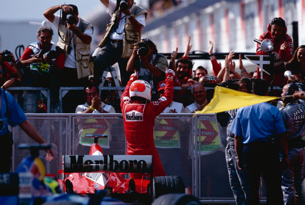 2002 Hungarian Grand Prix.Hungaroring, Budapest, Hungary. 16-18 August 2002.Rubens Barrichello (Ferrari) celebrates his 1st position in parc ferme after the race. Ref-02 HUN 32.World Copyright - Tee/LAT Photographic
