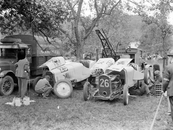 Mechanics work on a pair of Nacional Pescaras in the paddock.