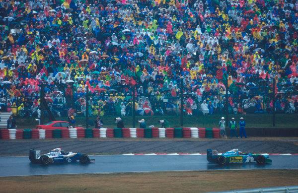 Suzuka, Japan. 4th - 6th November 1994. Michael Schumacher (Benetton B194 Ford) leads Damon Hill (Williams FW16B Renault).Ref-94 JAP 03.World Copyright - LAT Photographic