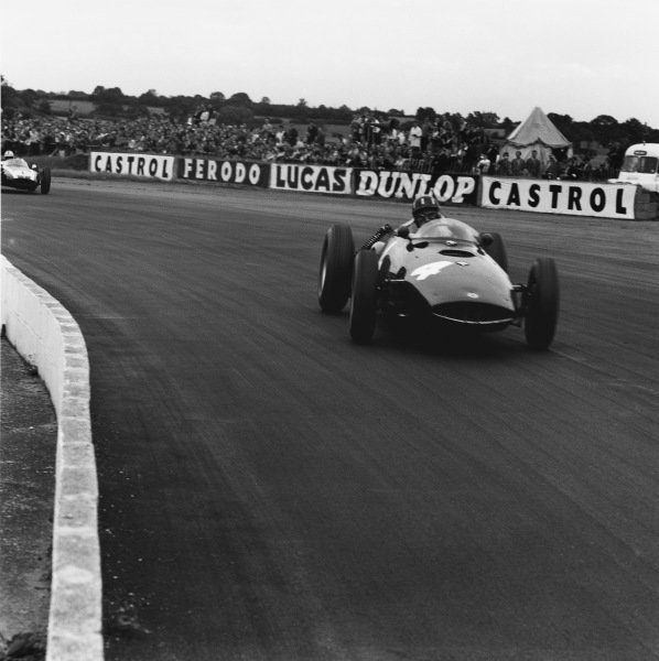 Silverstone, England. 16th July 1960.Graham Hill (BRM P48), retired, leads Jack Brabham (Cooper T53-Climax), 1st position, action. World Copyright: LAT Photographic.Ref:  6955.