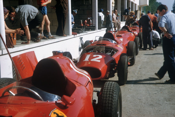 Rouen-Les-Essarts, France. 5-7 July 1957. Lancia-Ferrari 801s of Musso, Collins, Hawthorn and Trintignant lined up in the pits. Ref: 57FRA29. World Copyright - LAT Photographic