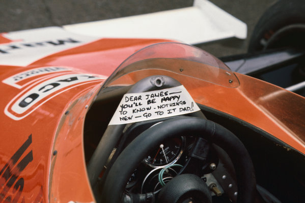 Fuji, Japan. 22nd - 24th October 1976. James Hunt (McLaren M23-Ford), 3rd position to clinch the World Championship title, is left a little message before the race, action.  World Copyright: LAT Photographic Ref: 76 JAP 45.