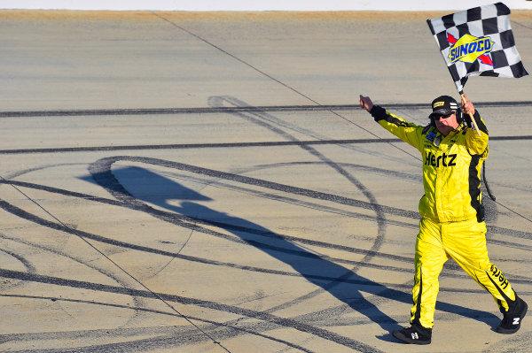 September 27-28, 2013, Dover, Delaware USA Joey Logano crewman with Checkered Flag. © 2013, Brian Czobat LAT Photo USA
