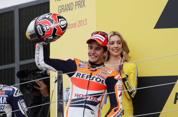 British Grand Prix.  Silverstone, England. 30th August - 1st September 2013.  Marc Marquez, Honda, celebrates on the podium.  Ref: IMG_2452a. World copyright: Kevin Wood/LAT Photographic