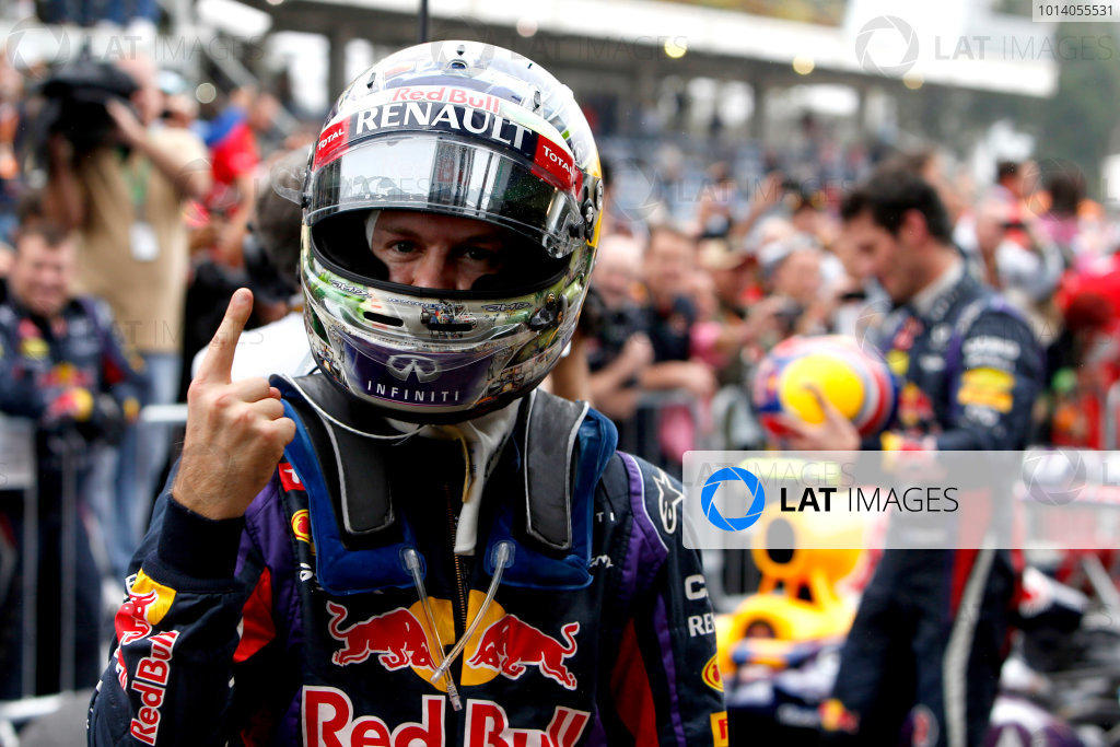 Interlagos, Sao Paulo, Brazil. Sunday 24th November 2013.  Sebastian Vettel, Red Bull Racing, 1st position, celebrates his 9th consecutive victory in Parc Ferme. World Copyright: Glenn Dunbar/LAT Photographic. ref: Digital Image _89P5798