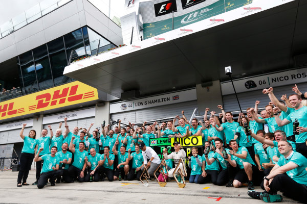 Red Bull Ring, Spielberg, Austria. Sunday 21 June 2015. Nico Rosberg, Mercedes AMG, 1st Position, and Lewis Hamilton, Mercedes AMG, 2nd Position, celebrate with their team. World Copyright: Alastair Staley/LAT Photographic. ref: Digital Image _R6T7244