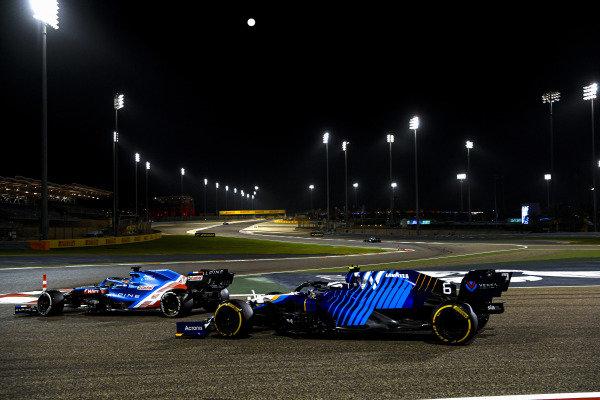 Fernando Alonso, Alpine A521, leads Nicholas Latifi, Williams FW43B