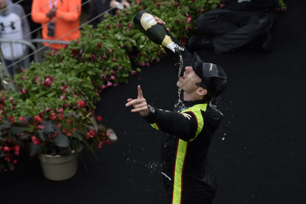 Simon Pagenaud, Team Penske Chevrolet celebrates the win in victory lane on the podium with champagne