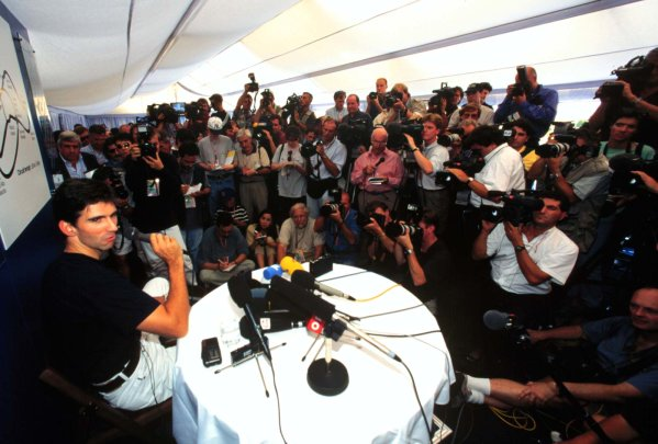 1996 Italian Grand Prix.Monza, Italy.6-8 September 1996.Damon Hill explains why he is leaving Williams Renault.World Copyright - LAT Photographic
