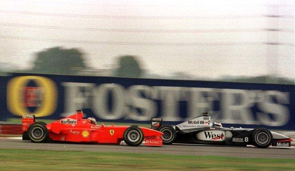 1998 Argentinian Grand Prix.Buenos Aires, Argentina.10-12 April 1998.Michael Schumacher (Ferrari F300) overtakes Mika Hakkinen (McLaren MP4/13 Mercedes-Benz) on the second lap to win.World Copyright - LAT Photographic