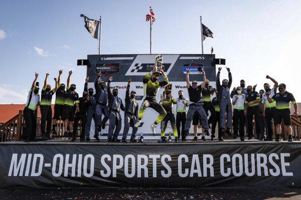 #14 AIM Vasser Sullivan Lexus RC-F GT3, GTD: Jack Hawksworth, Aaron Telitz and team celebrate with a Hawksworth stage dive, podium
