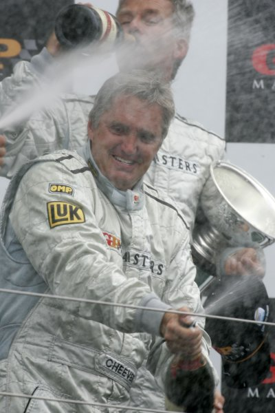 2006 Grand Prix Masters.Silverstone, England. 11th 13th August 2006.Sunday Race.Eddie Cheever celebrates victory on the podium.World Copyright: Alastair Staley/LAT Photographicref: Digital Image _F6E3363
