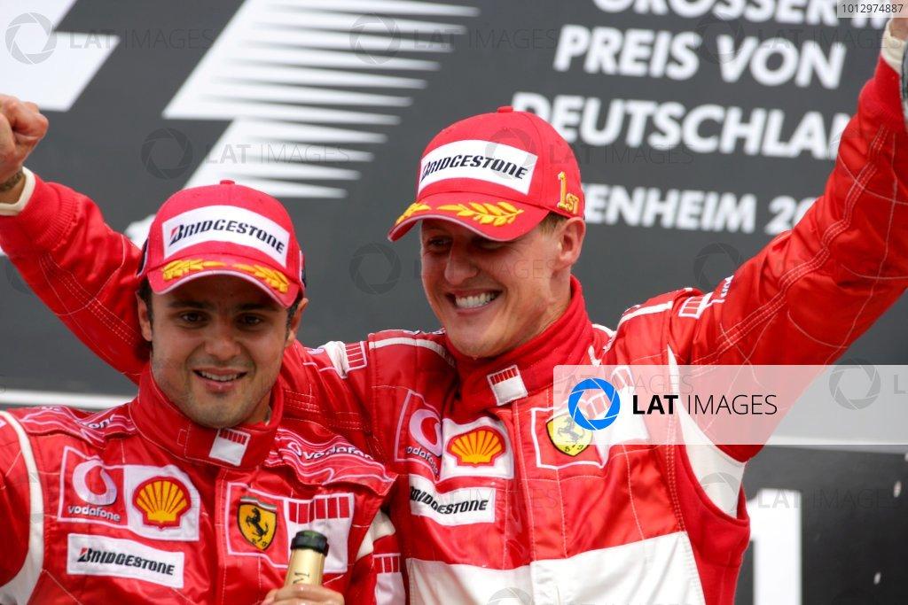 2006 German Grand Prix - Sunday Race Hockenheim, Germany. 27th - 30th July. Michael Schumacher, Ferrari 248F1, 1st position, celebrates his 89th win and 70th for Ferrari, with Felipe Massa, Ferrari 248F1, 2nd position, podium. World Copyright: Lorenzo Bellanca/LAT Photographic ref: Digital Image ZD2J2133