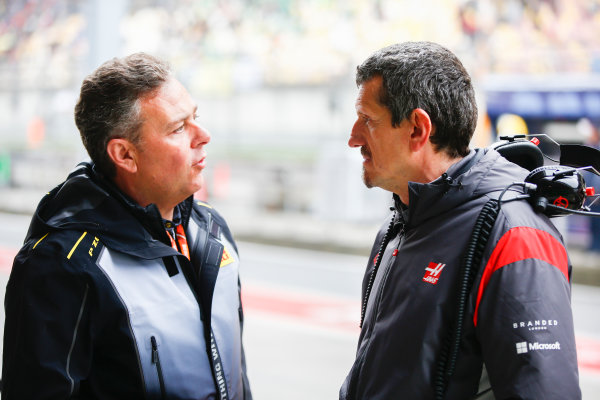 Shanghai International Circuit, Shanghai, China.  Friday 7 April 2017. Mario Isola, Racing Manager, Pirelli Motorsport, with Guenther Steiner, Team Principal, Haas F1. World Copyright: Andrew Hone/LAT Images ref: Digital Image _ONZ4203