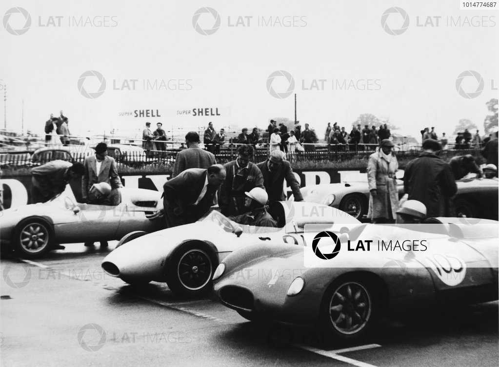 1958 United States Air Force Trophy. Silverstone, England. 12th July 1958. Tim Parnell (Cooper T46-Climax), 1st position, chats to his father, Reg Parnell on the grid before the start, portrait.  World Copyright: LAT Photographic. Ref:  B/WPRINT.