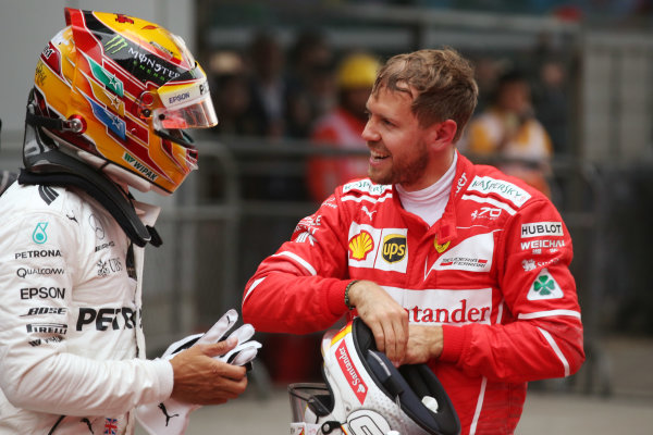 Shanghai International Circuit, Shanghai, China.  Sunday 09 April 2017.  Sebastian Vettel, Ferrari, 2nd Position, congratulates Lewis Hamilton, Mercedes AMG, 1st Position, in Parc Ferme. World Copyright: Charles Coates/LAT Images  ref: Digital Image AN7T0855