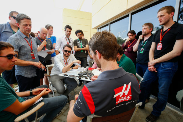 Bahrain International Circuit, Sakhir, Bahrain.  Thursday 13 April 2017. Romain Grosjean, Haas F1, talks to the media in the paddock. World Copyright: Andy Hone/LAT Images ref: Digital Image _ONY6155