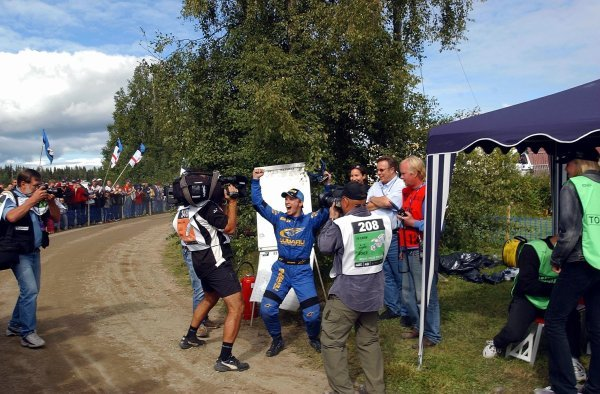 Petter Solberg (NOR), Subaru, is told that he has snatched second place from Richard Burns (GBR), Peugeot. He celebrated as though he had won the rally!FIA World Rally Championship, Rd9, Neste Rally Finland, Jyvaskyla, Finland, Day 3, 10 August 2003.DIGITAL IMAGE