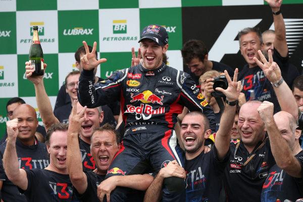 l Sunday 25th November 2012. Sebastian Vettel, Red Bull Racing, and the Red Bull Racing team celebrate a successful 2012 title campaign. World Copyright: Steve Etherington/c ref: Digital Image JSX3400 copy