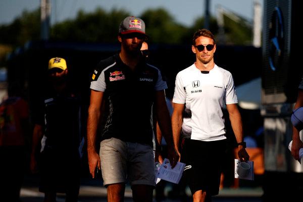 Hungaroring, Budapest, Hungary. Friday 22 July 2016. Carlos Sainz Jr, Toro Rosso, and Jenson Button, McLaren. World Copyright: Glenn Dunbar/LAT Photographic ref: Digital Image _W2Q6419