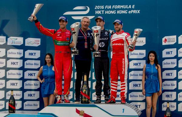 2016/2017 FIA Formula E Championship. Hong Kong ePrix, Hong Kong, China. Sunday 9 October 2016. Lucas Di Grassi (BRA), ABT Schaeffler Audi Sport, Spark-Abt Sportsline, ABT Schaeffler FE02, Sebastien Buemi (SUI), Renault e.Dams, Spark-Renault, Renault Z.E 16 and Nick Heidfeld (GER), Mahindra Racing, Spark-Mahindra, Mahindra M3ELECTRO on the podium. Photo: Zak Mauger/LAT/Formula E ref: Digital Image _X0W2970