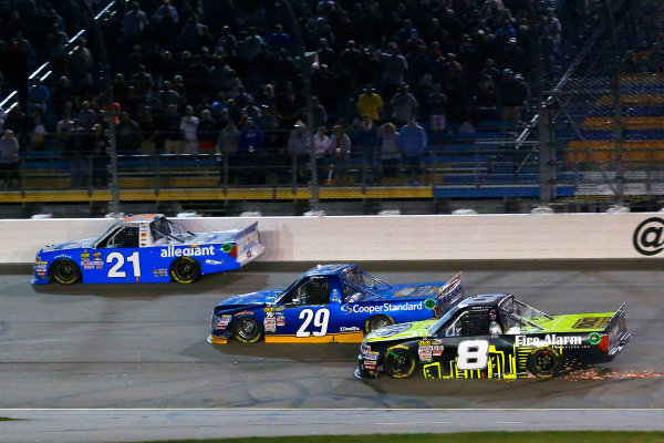 NASCAR Camping World Truck Series M&M?s 200 presented by Casey?s General Store Iowa Speedway, Newton, IA USA Friday 23 June 2017 Johnny Sauter, Allegiant Airlines Chevrolet Silverado, Chase Briscoe, Cooper Standard Ford F150 and John Hunter Nemechek, Fire Alarm Services/Romco Equipment Co. Chevrolet Silverado World Copyright: Russell LaBounty LAT Images