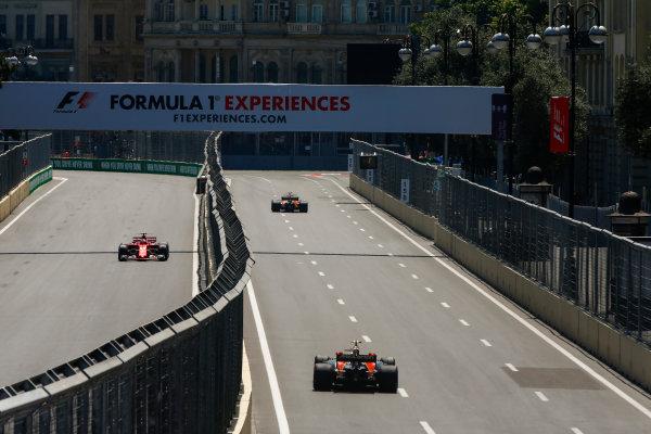 Baku City Circuit, Baku, Azerbaijan. Friday 23 June 2017. Sebastian Vettel, Ferrari SF70H, and Fernando Alonso, McLaren MCL32 Honda, leading Stoffel Vandoorne, McLaren MCL32 Honda. World Copyright: Andrew Hone/LAT Images ref: Digital Image _ONY8587