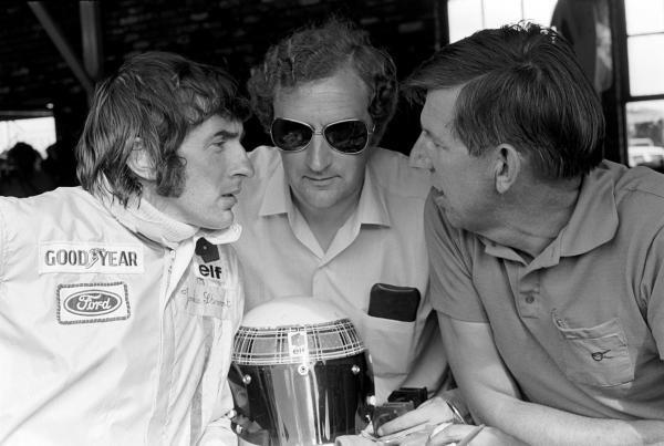 L to R: Jackie Stewart(GBR), Tyrrell designer Derek Gardner(GBR) and Ken Tyrrell(GBR) South African GP, Kyalami, 6 March 1971