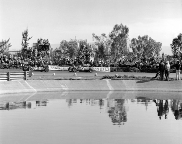 1965 Mexican Grand Prix.Mexico City, Mexico. 24 October 1965.Pedro Rodriguez leads Lorenzo Bandini (both NART Ferrari 1512). They finished in 7th and 8th position respectively.World Copyright: LAT PhotographicRef: 31722