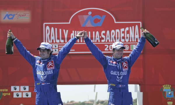 2006 FIA World Rally Championship.Round 7. 18th - 21st May 2006.Rally of Italy, Sardinia.Sebastien Loeb, Citroen, Podium.World Copyright: McKlein/LAT
