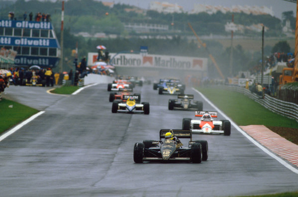 1985 Portuguese Grand Prix. Estoril, Portugal. 19th - 21st April 1985. Ayrton Senna (Lotus 97T-Renault), 1st position, leads the field on the formation lap before the start of the race, action. World Copyright: LAT Photographic. Ref:  85POR40.