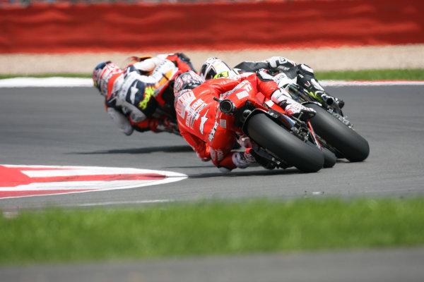Great Britain Silverstone 18-20 June 2010Nicky Hayden Ducati Marlboro Team tracks Randy de Puniet and Andrea Dovizioso