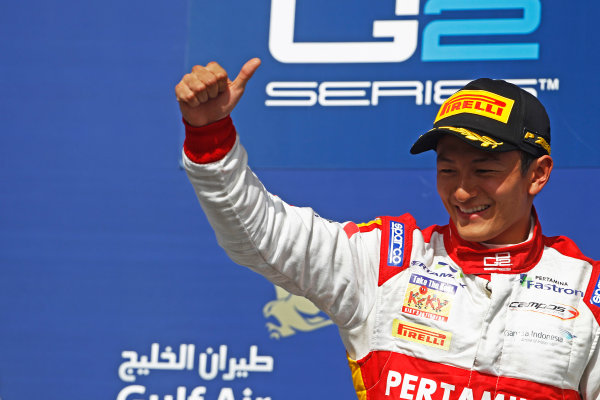 2015 GP2 Series Round 1 - Bahrain International Circuit, Bahrain. Sunday 19 April 2015. Rio Haryanto (INA, Campos Racing) celebrates his win on the podium. Photo: Sam Bloxham/GP2 Series Media Service. ref: Digital Image _G7C8910