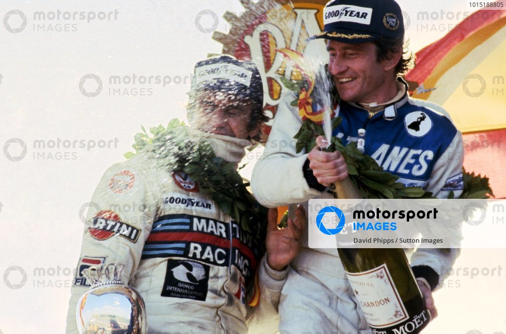 Race winner Patrick Depailler (FRA) Ligier (Right) celebrates with second placed Carlos Reutemann (ARG) Lotus (Left) on the podium.
