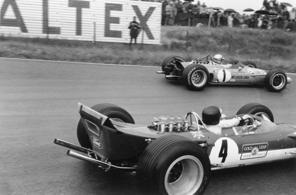 1968 Dutch Grand Prix.Zandvoort, Holland. 23 June 1968.Denny Hulme (McLaren M7A-Ford Cosworth, number 1) and Jackie Oliver (Lotus 49B-Ford Cosworth). Ref-834C #34A.World Copyright - LAT Photographic