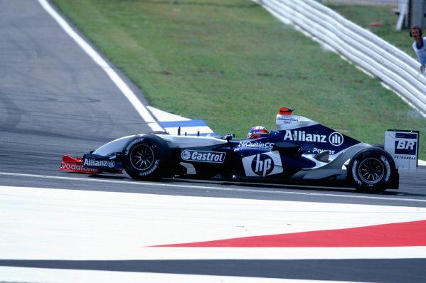 2004 German Grand PrixHockenheim, Germany. 23rd - 25th July.Juan Pablo Montoya, BMW Williams FW26 runs over Rubens Barrichello's, Ferrari F2004 front wing. Action. World Copyright:Peter Spinney/LAT Photographic Ref:35mm Image:A05