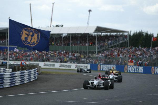 2003 British Grand Prix - Sunday race, Silverstone, England.20th July.Jacques Villeneuve, BAR Honda 005, leads his team-mate Jenson Button, B-A-R Honda 005, action.World Copyright LAT Photographic.Digital Image Only.