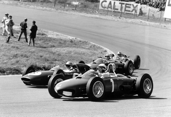 1962 Dutch Grand Prix Zandvoort, Holland. 18-20 May 1962 Phil Hill (#1 Ferrari Dino 156) takes a wide line through Tarzan Corner. Trevor Taylor (Lotus 24-Climax), Ricardo Rodriguez (Ferrari Dino 156) and Jack Brabham (Lotus 24-Climax) are on the inside. Taylor and Hill finished in 2nd and 3rd position respectively World Copyright: LAT PhotographicRef: Autosport b&w print