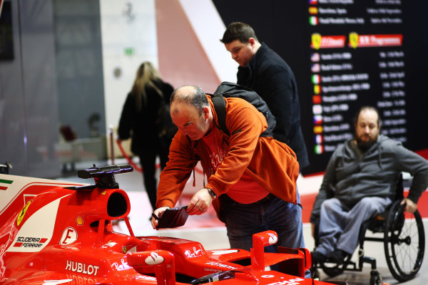 Autosport International Exhibition. National Exhibition Centre, Birmingham, UK. Sunday 14th January 2018. A visitor takes a picture of a Ferrari Formula 1 car.World Copyright: Mike Hoyer/JEP/LAT Images Ref: MDH10323