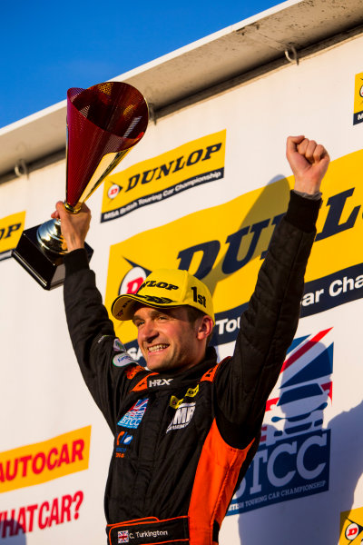 2015 British Touring Car Championship, Silverstone, Northamptonshire, England. 26th - 27th September 2015. Colin Turkington (GBR) Team BMR Volkswagen Passat CC, 1st position, celebrates on the podium. World Copyright: Zak Mauger/LAT Photographic. ref: Digital Image _L0U4833