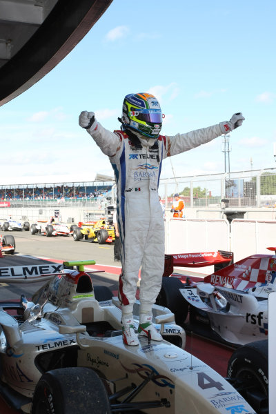 Silverstone, England. 11th July.Sunday Race. Sergio Perez (MEX, Barwa Addax Team) celebrates his victory. Photo: Jakob Ebrey/GP2 Media Service.Ref: _MKO_9251 jpg