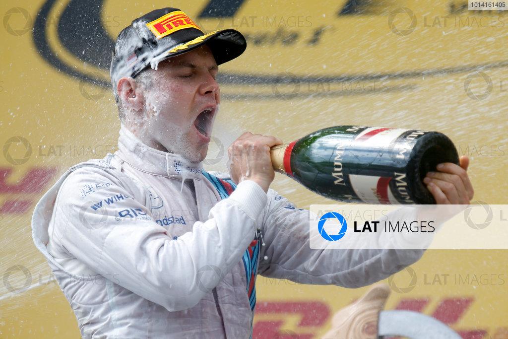 Red Bull Ring, Spielberg, Austria. Sunday 22 June 2014. Valtteri Bottas, Williams F1, 3rd Position, sprays the Champagne. World Copyright: Alastair Staley/LAT Photographic. ref: Digital Image _R6T4863