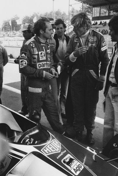 Zolder, Belgium. 14th - 16th May 1976. James Hunt (McLaren M23-Ford), in conversation with Niki Lauda (Ferrari 312T2), portrait.  World Copyright: LAT Photographic. Ref: L76 - 741 - 17.