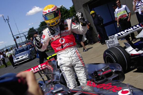 Lewis Hamilton celebrates his first F1 pole position in parc fermé.